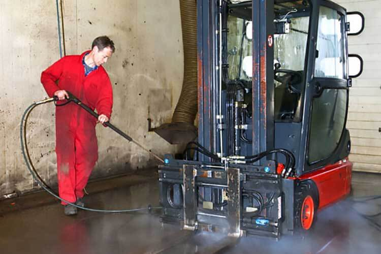 Degreaser being used on a forklift